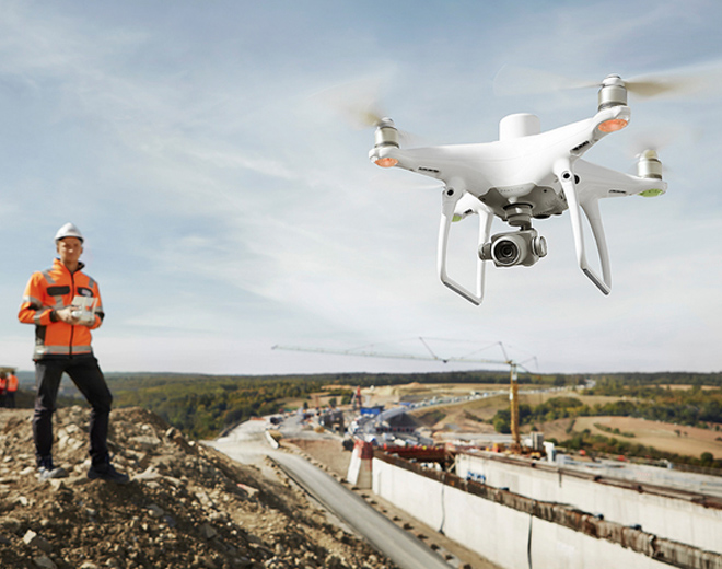 man flying DJI Phantom 4 RTK. Coptrz Commercial Drone Experts
